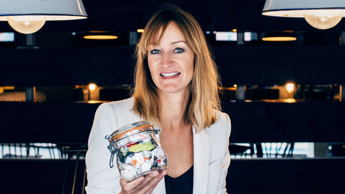 Bea Johnson (Zero Waste Home) a zero-waste blogger holding a year's worth of trash in a small jar