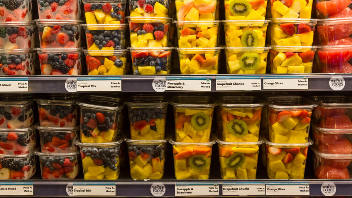 Fruits in plastic containers at a supermarket that will have a negative impact on human health