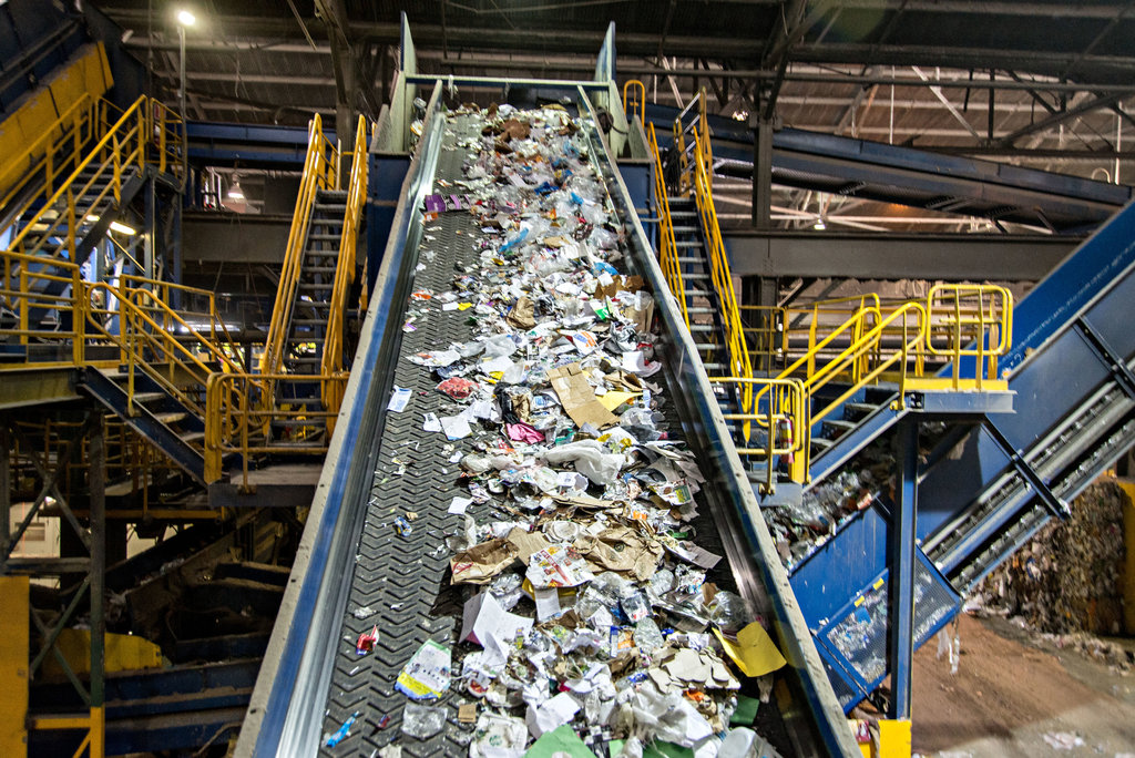 A recycling factory belt with different types of wastes on it on their way to be recycled