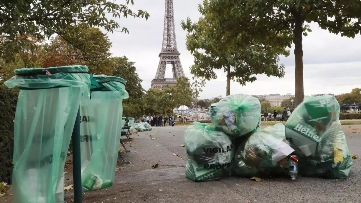 Trash cans in front of the Eiffel Tower in France