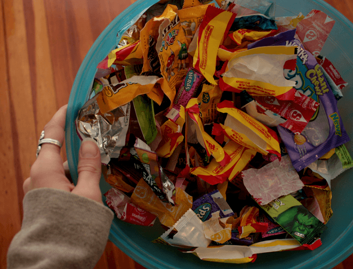 A bin full of plastic wrappers of chips and chocolates which are one of the major contributors to plastic pollution