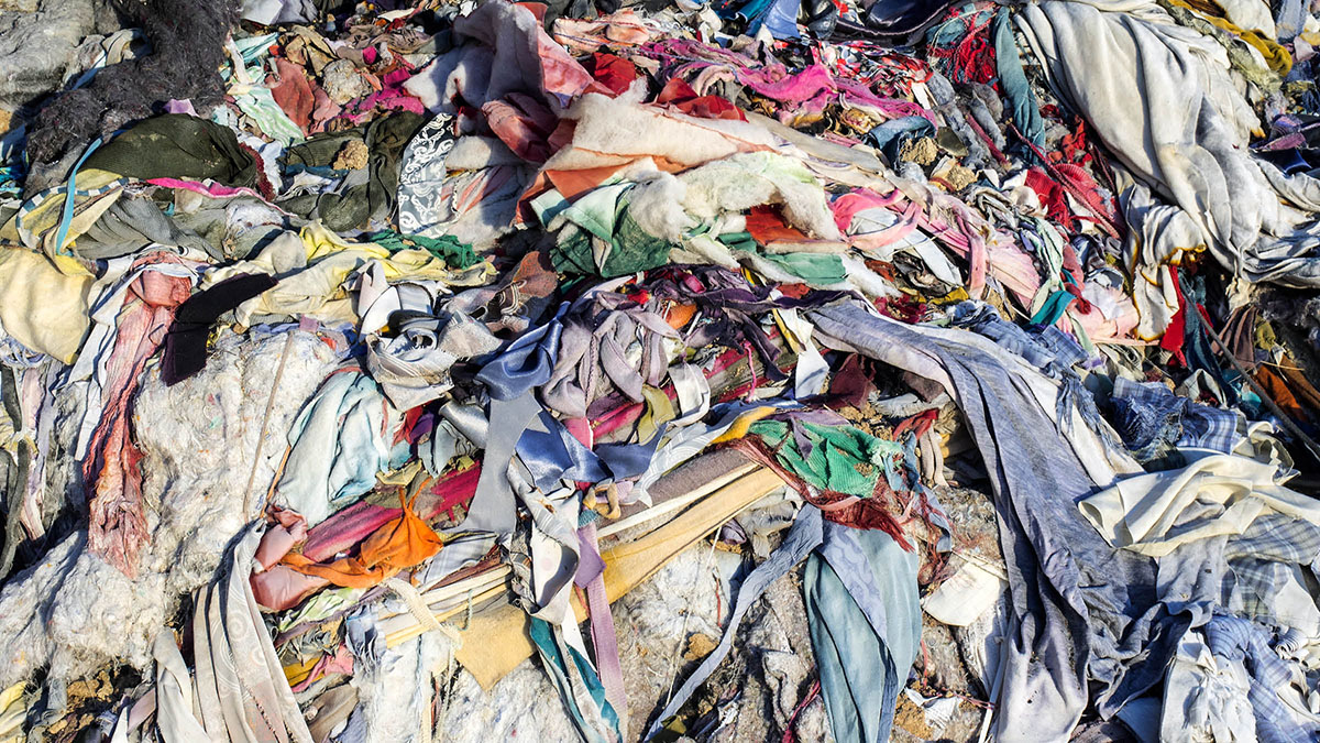 A landfill full of clothes from the fast fashion industry
