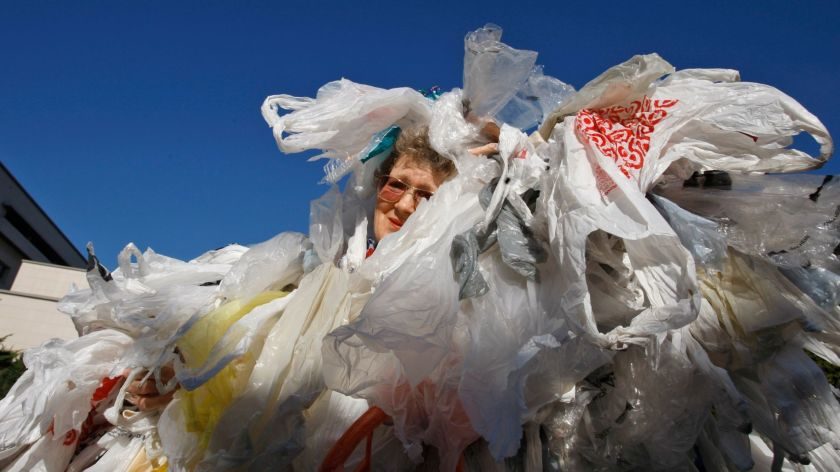A woman covered in plastic bags