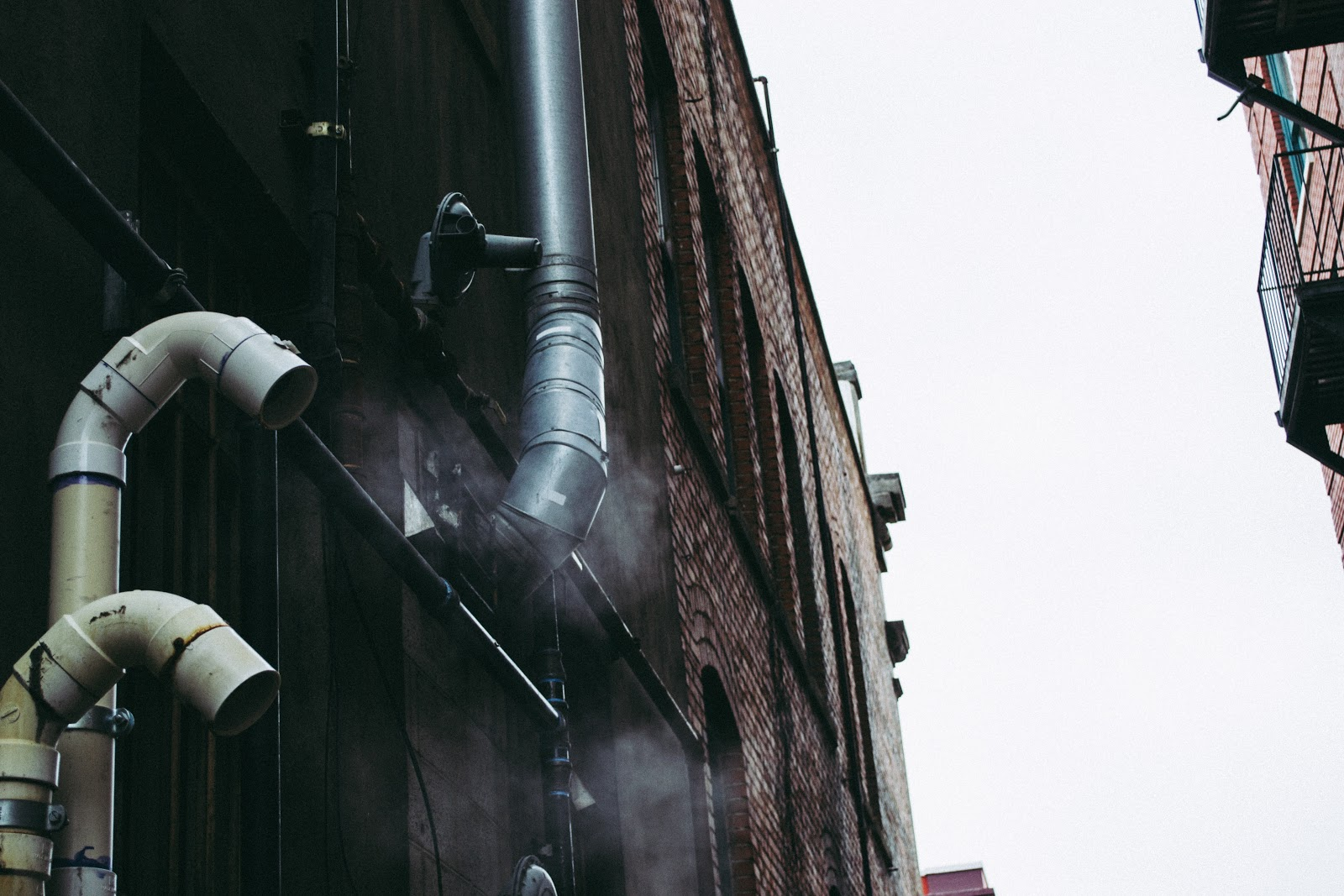 PVC Plastic (one of the 7 types of plastics) pipes outside a building