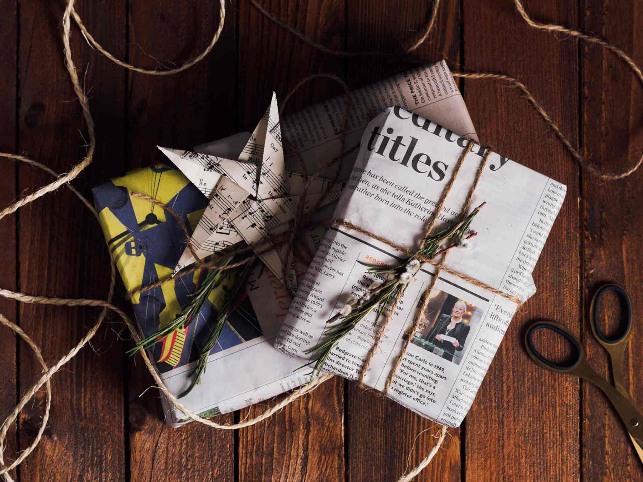 Christmas gifts wrapped with newspaper to celebrate a zero waste Christmas