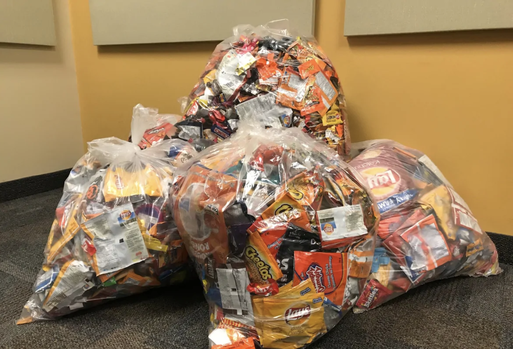 Bags of low value plastic wrappers of chips and chocolates