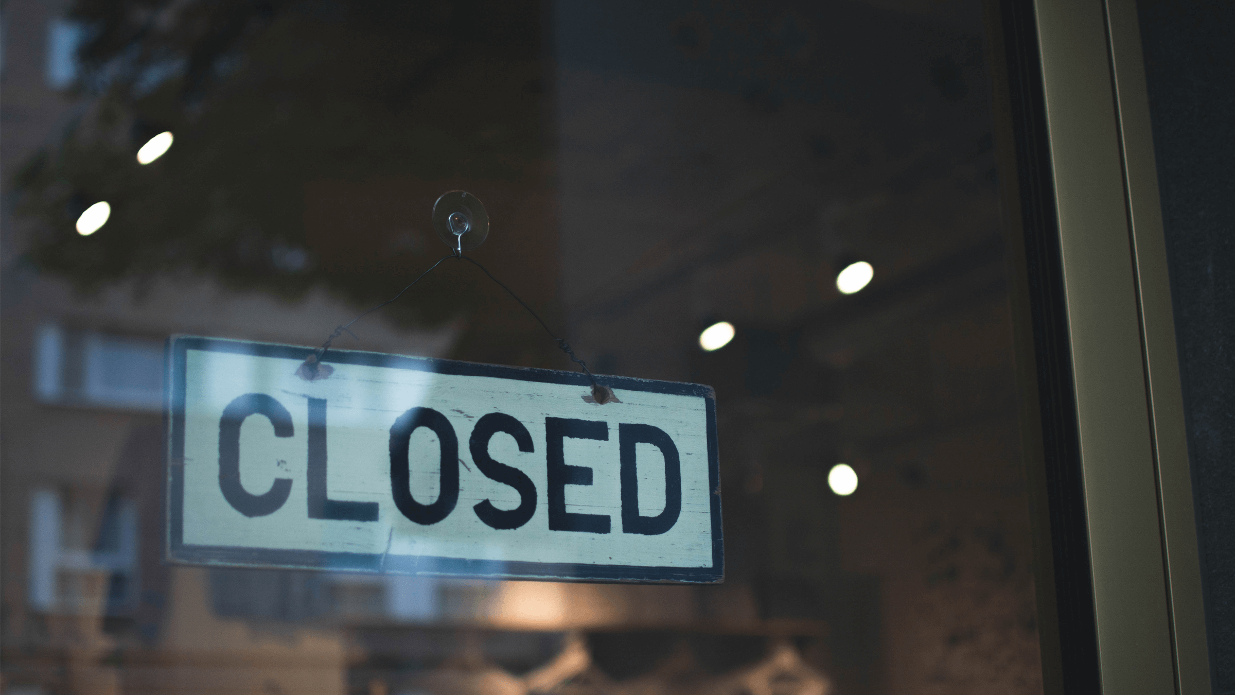 Closed sign through window
